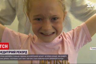 Новини світу: 8-річна дівчинка з Канади підняла штангу, що втричі важча за неї