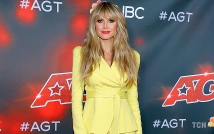В лимонном костюме и с ярким мейк-апом: Хайди Клум блистала на красной дорожке