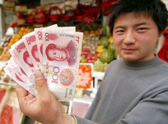 Китайський юань (Фото: businessweek.com)