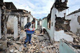 Українка з двома дітьми втекла зі спаленого мародерами Ошу