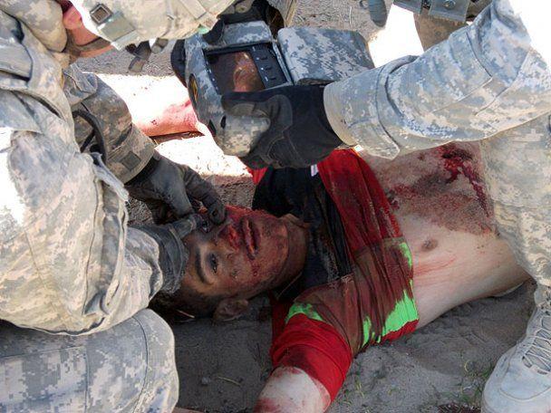 Опубликованы новые фото и видео издевательств американских солдат над афганцами