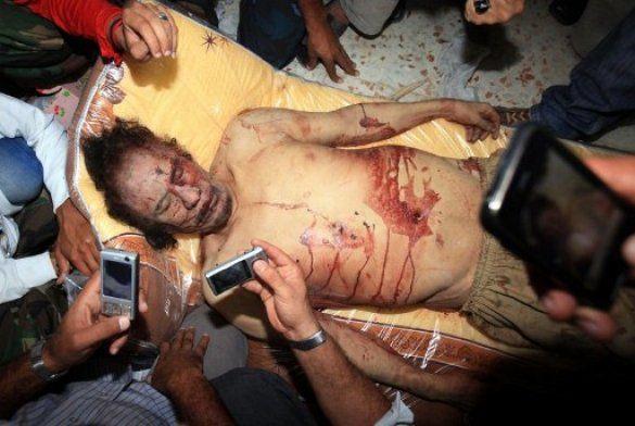 Журналістам показали оголений труп Каддафі_5