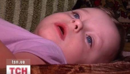 Ребенок собирает ребенку на операцию