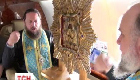 Священники Московского патриархата помолились за Украину на борту самолета