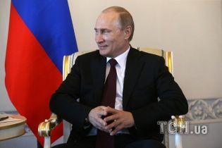 Путін на мітингу у річницю окупації Криму назвав українців і росіян братами