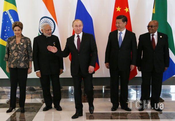 Незвично веселий Путін та кокетлива Меркель. Емоції учасників саміту G20