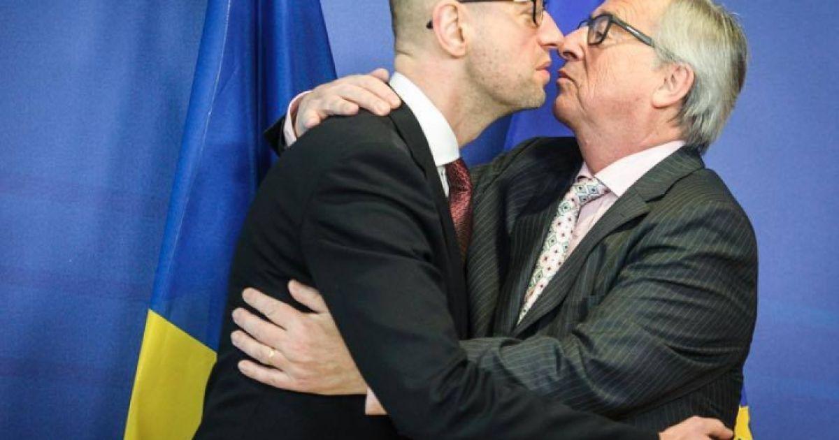 Декабрь 2015 года. Президент Еврокомиссии Жан-Клод Юнкер приветствует премьера Арсения Яценюка