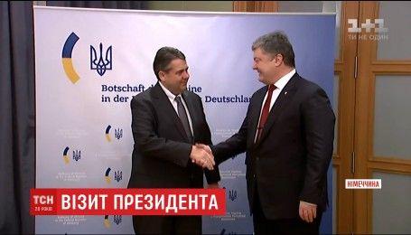 Порошенко призвал Германию совместно с другими странами заставить РФ выполнять Минские соглашения