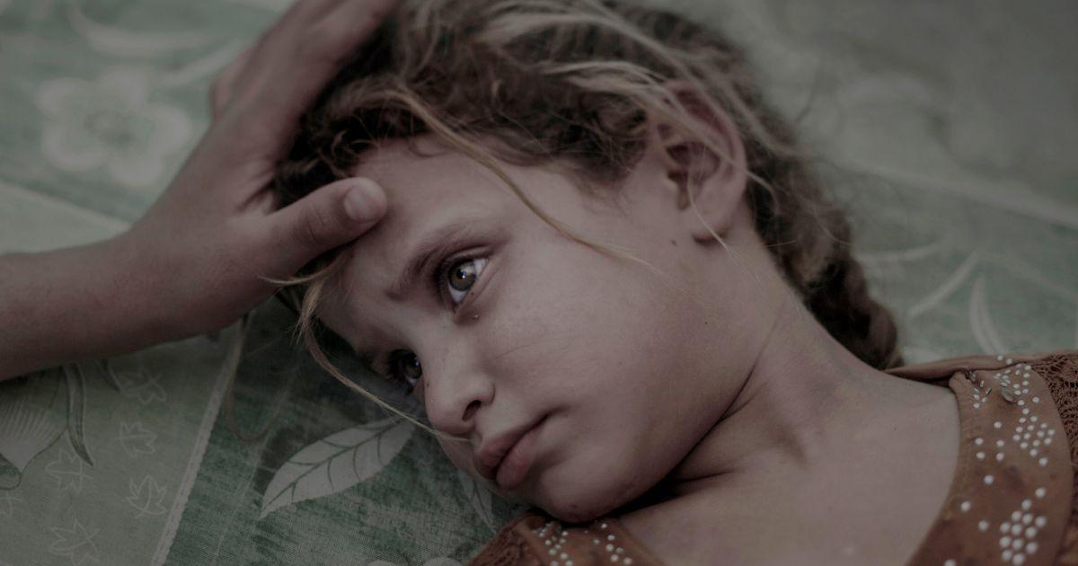Перше місце в категорії «Люди». На фотографії: п'ятирічна Маха, сім'я якої бігла з села Хавіджа під Мосулом, Ірак. @ Reuters