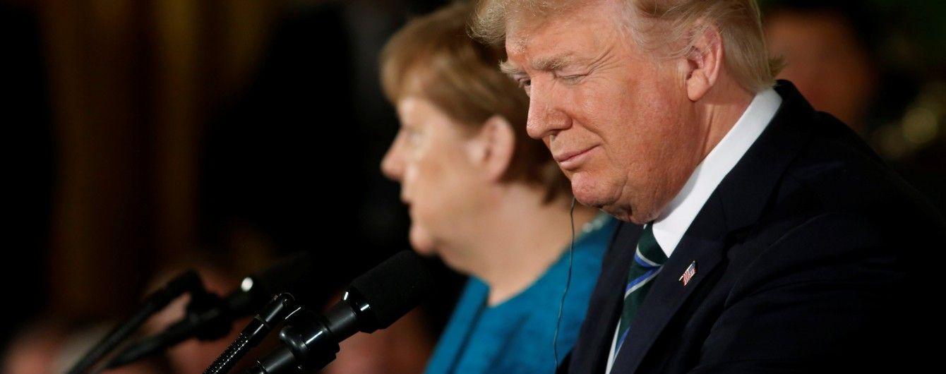 """Трамп заявил о """"решительной поддержке"""" НАТО и призвал Меркель увеличить расходы на оборону"""