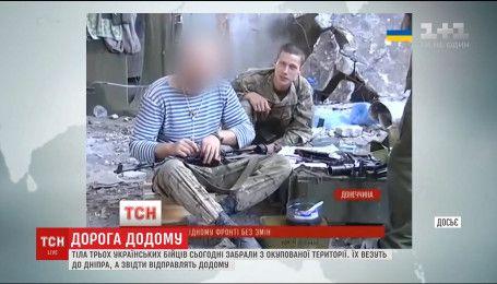 Тела трех украинских бойцов забрали из оккупированной территории