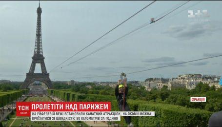 На Эйфелевой башне установили полукилометровый троллей, натянутый на высоте 115 метров
