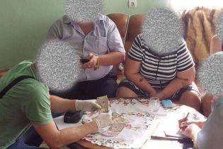 Медик и коммунальщик: в ГПУ сообщили о двух задержанных взяточниковах на Закарпатье и Черкасщине