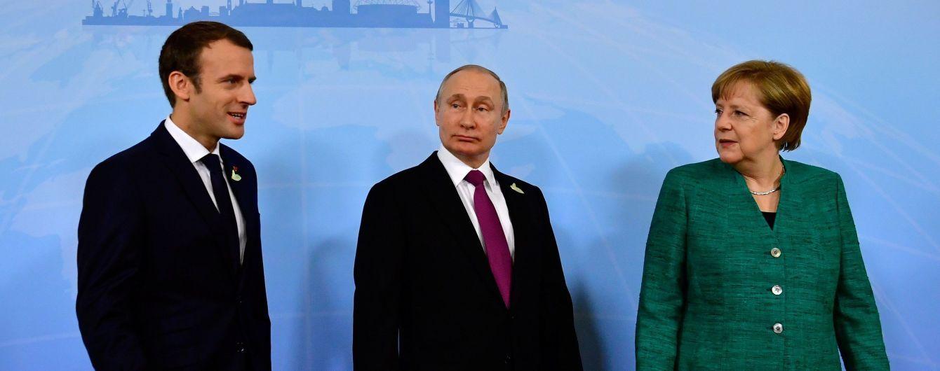 """Меркель пояснила """"зустріч трьох"""" стосовно України недосвідченістю Макрона"""