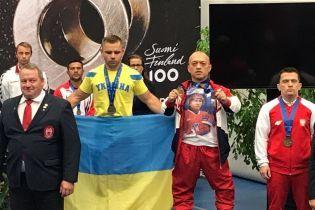 Російського спортсмена забанили за футболку з Путіним