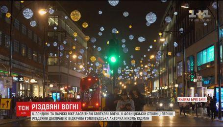 В Лондоне и Париже зажгли первые рождественские огни
