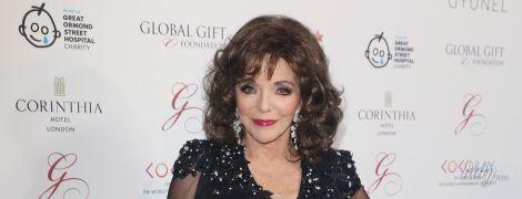 С эффектным макияжем и на шпильках: 84-летняя Джоан Коллинз пришла на гала-вечер в элегантном образе