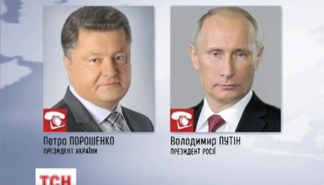 Порошенко по телефону призвал Путина примкнуть к своему мирному плану