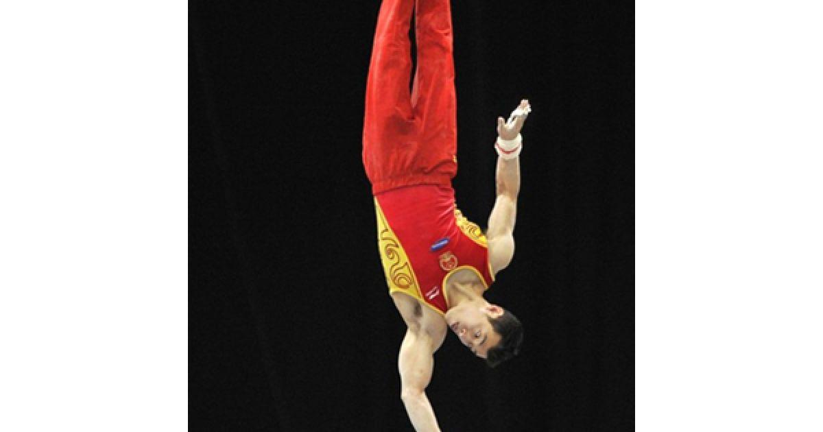 Виступ китайського спортсмена Бо Лу на Чемпіонаті Світу зі спортивної гімнастики у Роттердамі. @ AFP