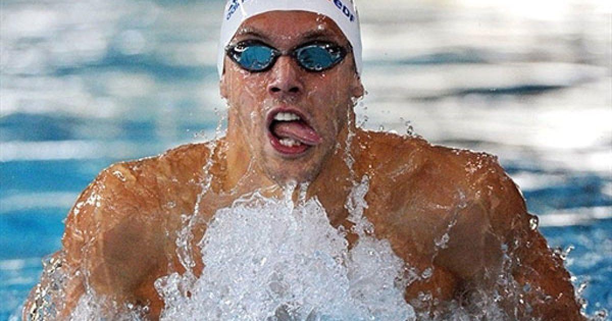 Франція, Шильтігхейм. Французький плавець Хью Дюбоск показує язик під час запливу на 100 м брасом на Чемпіонаті Франції з плавання. @ AFP