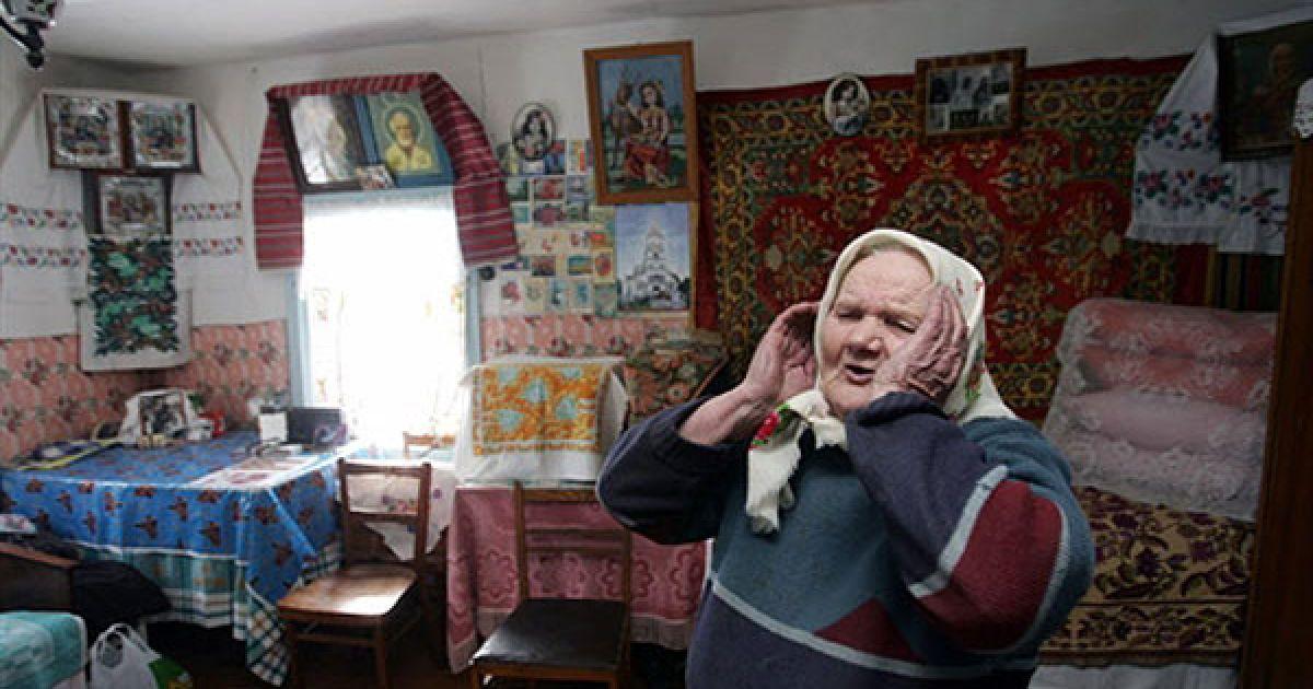 Україна, село Ільїнці, 30-км зона, 2006 рік. Марія Шапоренко, 81 рік. @ AFP