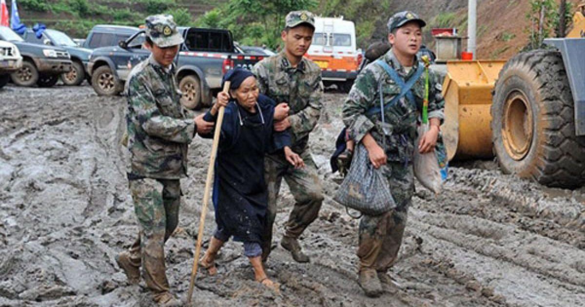 У результаті зсуву 28 червня на південному заході Китаю під завалами опинилося, щонайменше, 150 осіб. @ AFP