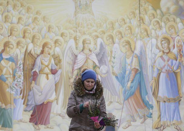Гілки верби і бризки святої води. Як у Києві відзначають Вербну неділю