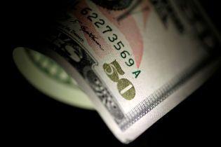У Києві прокурор з екс-співробітником ГПУ вимагали десятки тисяч доларів хабара
