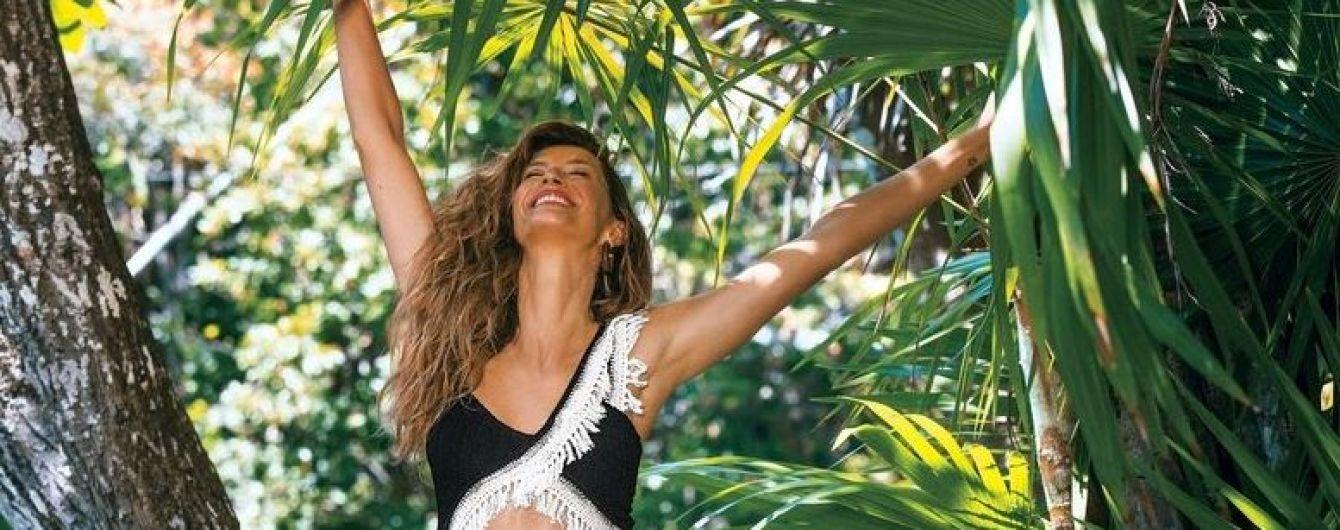 На плоту и лианах в джунглях: Жизель Бундхен снялась в летней фотосессии