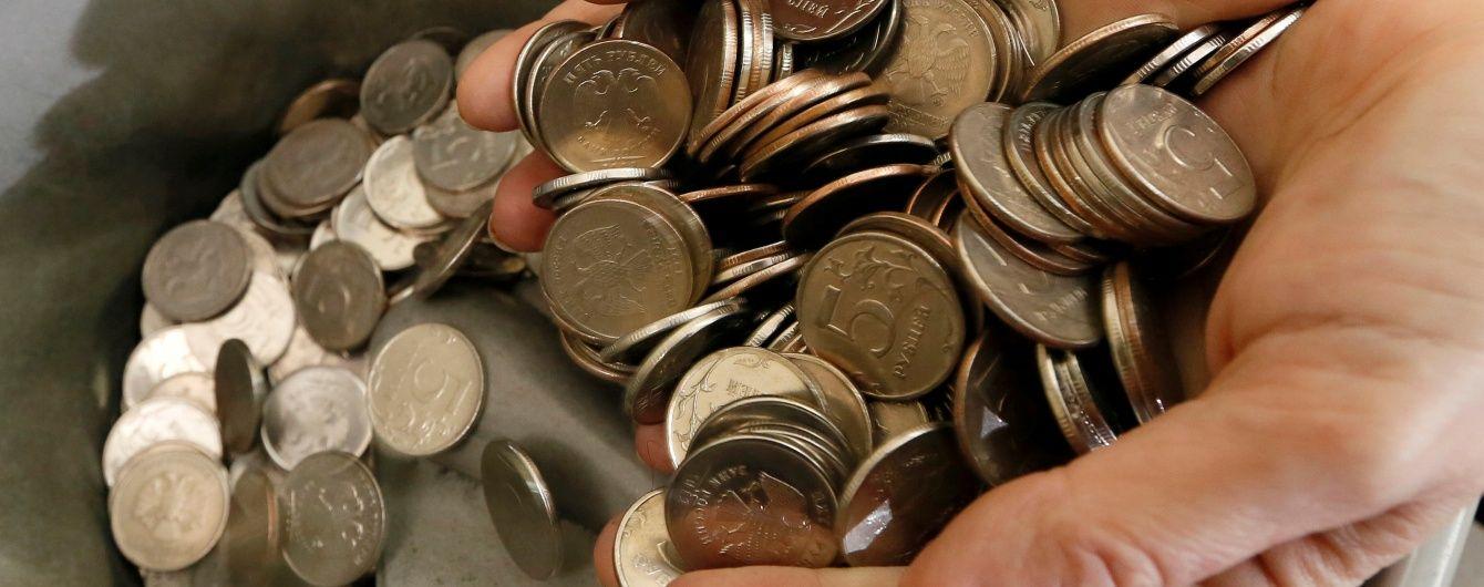 Центробанк РФ на фоне обвала рубля вдвое уменьшил объем закупки для Минфина