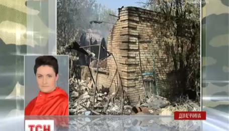 Мешканці спалених в Мар'їнці будинків дивуються, як  їм пощастило вижити після обстрілу