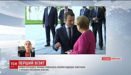 Новый президент Франции встретился с Ангелой Меркель во время первого зарубежного визита