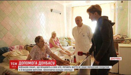 Героїчні військові лікарі рятують звичайних жителів Донбасі на фронті