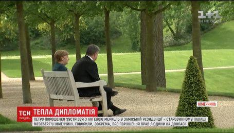 Канцлер Германии пригласила Порошенко в свою загородную резиденцию