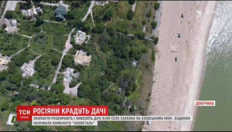 """Оккупанты продолжают вывозить дома дачного поселка комбината """"Азовсталь"""""""