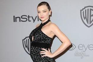 Миранда Керр подчеркнула беременный живот платьем с леопардовым принтом