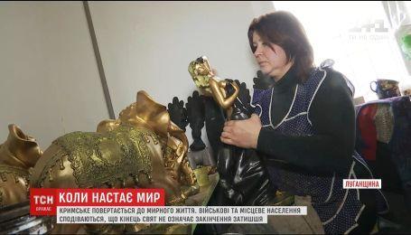 Мистецтво на передовій та укріплення позицій: селище Кримське оговтується під час перемир'я