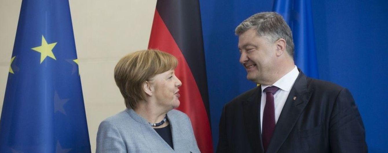 Війна на Сході, енергетика та торгівля. У Києві відбудуться перемовини Порошенка та Меркель