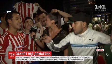Журналістка у прямому ефірі побила мікрофоном хтивого футбольного фаната