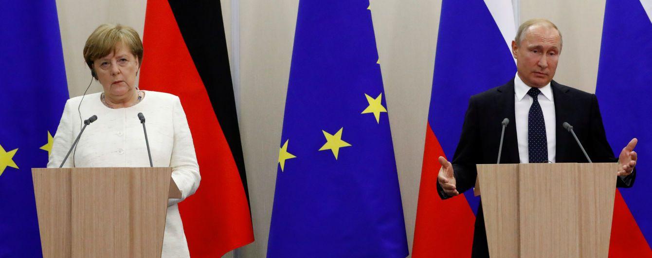 Путін став на захист пропагандиста Вишинського перед Ангелою Меркель