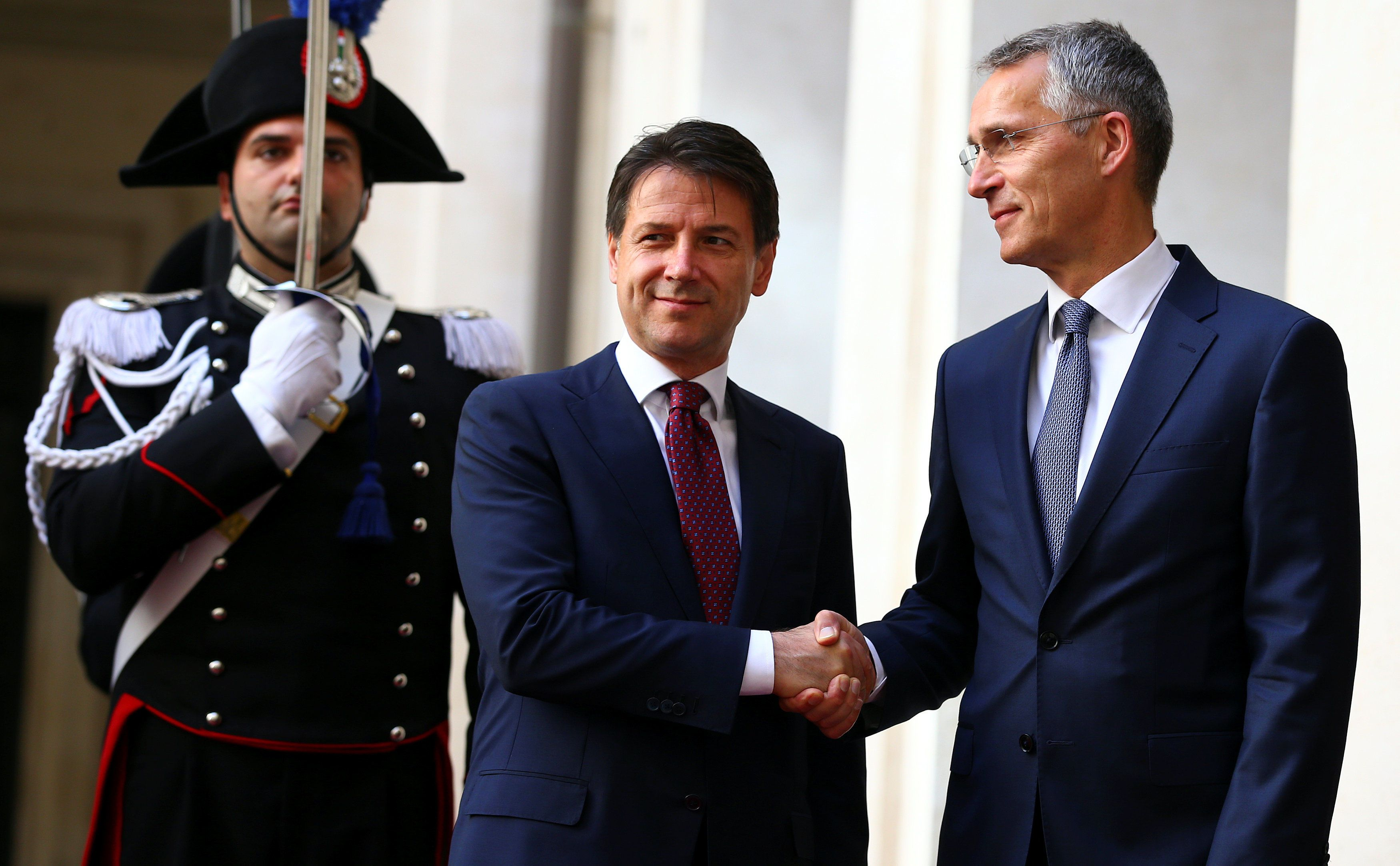 Jens Stoltenberg and  Conte