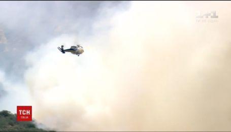 Огонь лесных пожаров угрожает богачам из Беверли-Хиллз