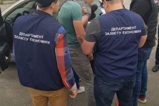 На Київщині депутат погорів на хабарі в 1 млн гривень за місця для поховання померлих