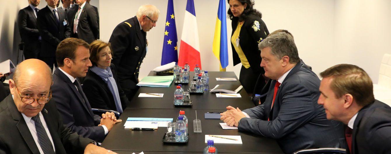 Путін відповідальний за жертви в Україні. Про що говорив Порошенко на симпозіумі НАТО