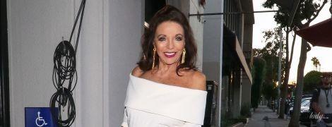 85-річна Джоан Коллінз сходила на вечерю в обтислій сукні з оголеними плечима