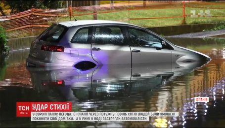 Потужні повені та зливи: Іспанію та Італію накрила негода