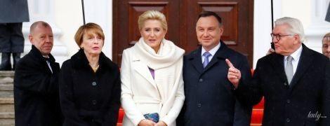 Дождь не помеха: элегантные образы первых леди Германии и Польши