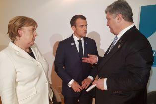 """Миротворцы на Донбассе и осуждение """"псевдовыборов"""": Порошенко в Париже провел переговоры с Меркель и Макроном"""