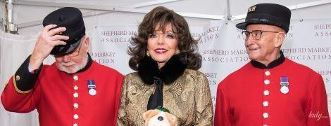 В золотом пальто и с насыщенным макияжем: 85-летняя Джоан Коллинз зажгла огни на пастушьем рынке
