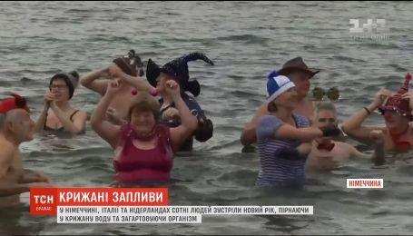 Сотни европейцев встретили Новый год, ныряя в ледяную воду
